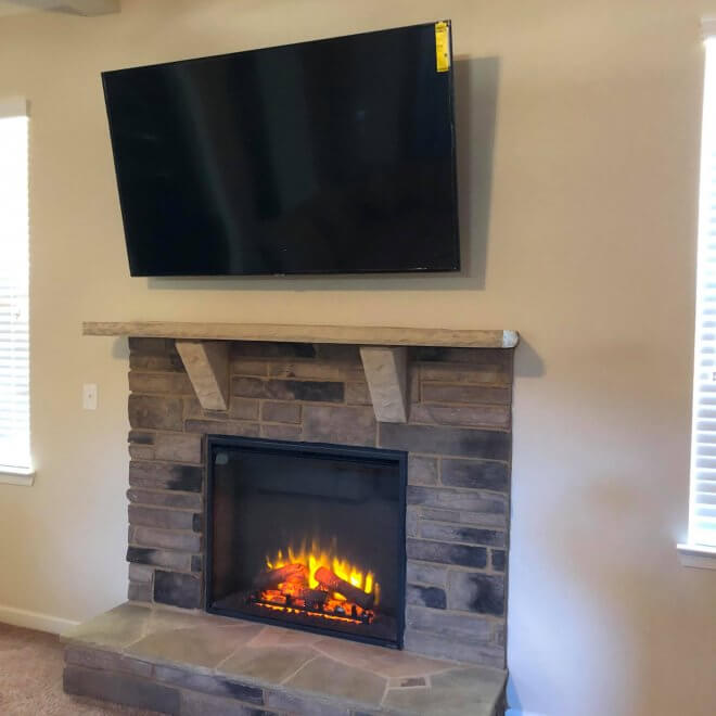 70 inch TV above a fireplace in Sandy Springs, GA