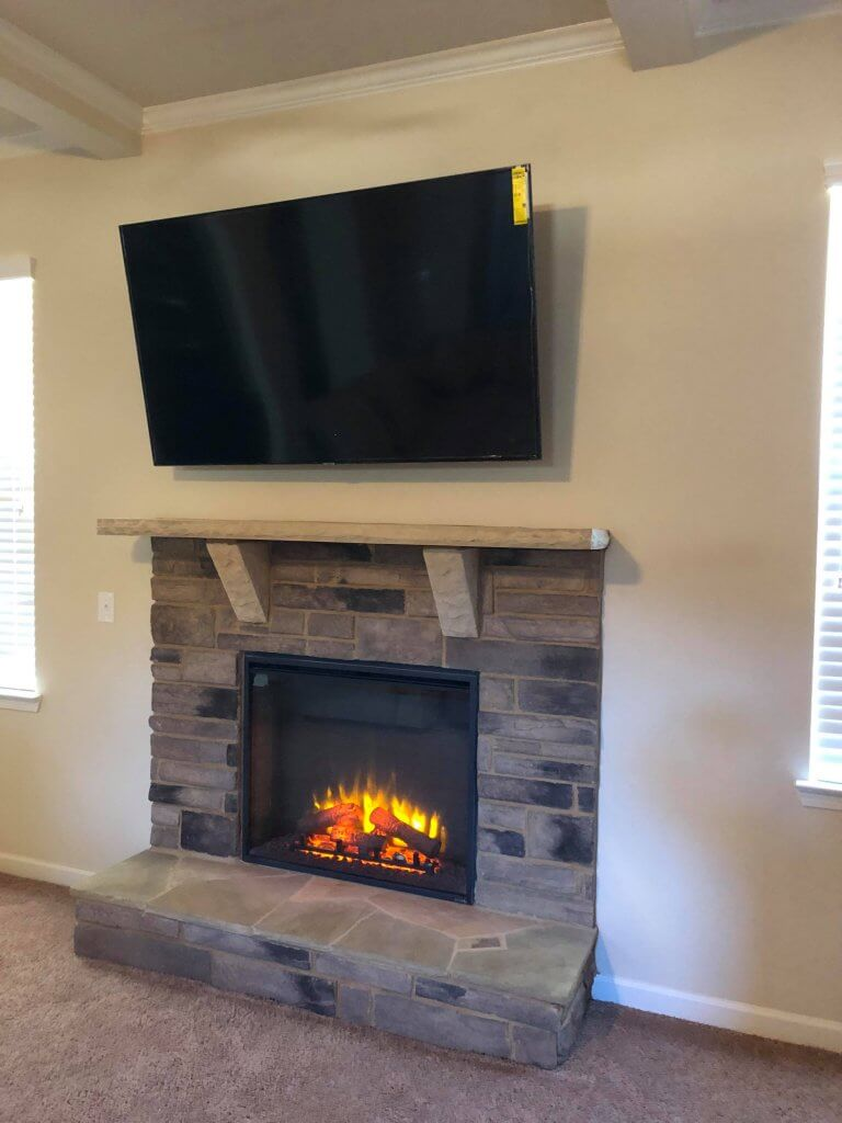 70 inch tv above a fireplace in sandy springs ga tv mounting rh expressmounting com  70 inch tv mounted over fireplace